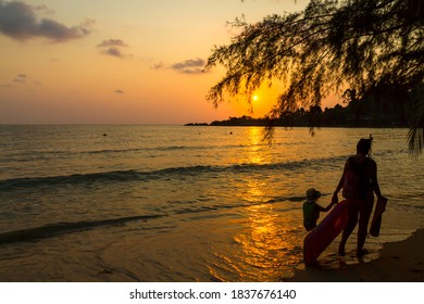 Sunset and family of traveler walk on beach at Koh Chang Thailand.Koh Chang is located in the eastern Gulf of Thailand. It is an island with beautiful nature. Famous for tourism