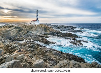 Sunset in Favaritx Lighthouse on Minorca Island north eastern shore, Balearic Islands, Spain.