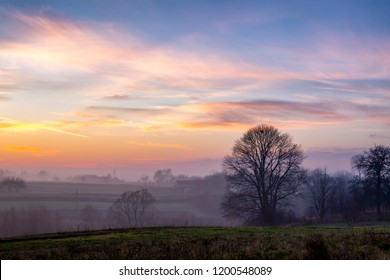 sunset in the field. beautiful autumn foggy landscape in Ukraine