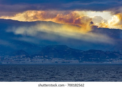 Sunset with fire and sea. Smog and fire in background.