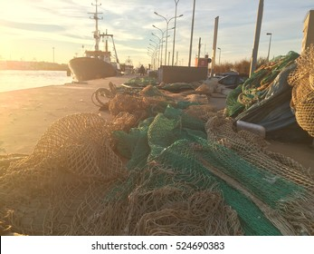 sunset with fishing nets in the harbor of Fiumicino, Rome, Italy