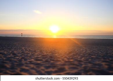 sunset flooded the beach sand