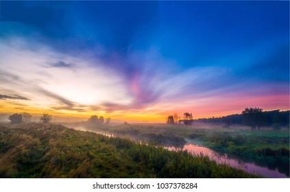 Sunset fog rural river landscape. Rural river sunset fog panorama