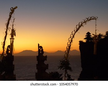 Sunset forming silhouette of Balinese decoration