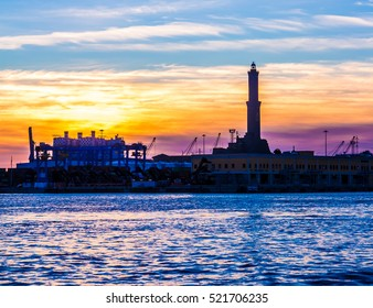 sunset at Genoa's port, silhouette of the Lanterna: the main lighthouse and symbol of the city, in Italy
