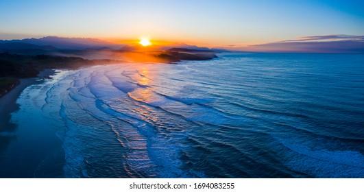 Sunset at Gerra Beach, Oyambre Natural Park, San Vicente de la Barquera Municipality, Cantabrian Sea, Cantabria Autonomous Community, Spain, Europe - Shutterstock ID 1694083255