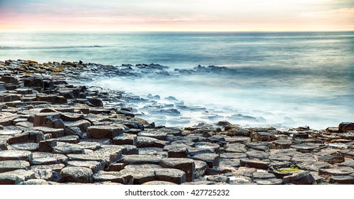 Sunset at Giants Causeway, near Bushmills, County Antrim, Northern Ireland, UK.
