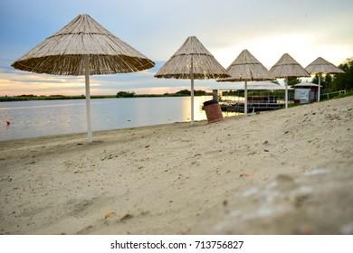 sunset glow parasols on beautiful sandy beach