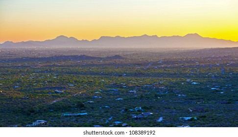 sunset with golden mountain panorama in Tuscon, Arizona