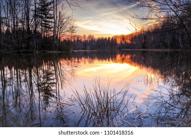 Sunset in the golden sunlight over a mountain lake in the Ore Mountains. Mountain lake near the town of Schneeberg.