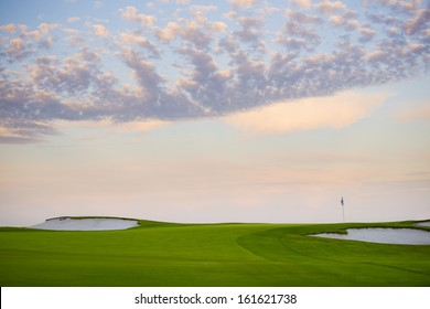 sunset at golf course with flag