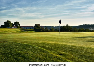Sunset and golf course with flag. Europe
