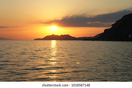 Sunset in Greece with a sun touchdown