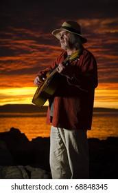 Sunset guitarist with dramatic lighting