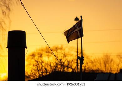 Sunset harbour flag bucket trees lightpole