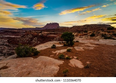 Sunset has arrived at the Maze Overlook in the Canyonlands National Park in Utah. Land formations are just about in silhouette.