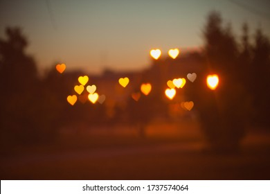 Sunset hearts bokeh texture background Valentine's day holidays background for letters love yellow orange pink brown warm color