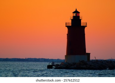 Sunset at Henlopen State Park was created to capture the smooth transition of color at sunset with heavy haze in the sky. The back-lighting of the sky created a silhouette of Breakwater Lighthouse.