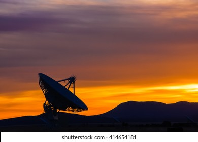 Sunset in the high desert of New Mexico, featuring a radio telescope.
