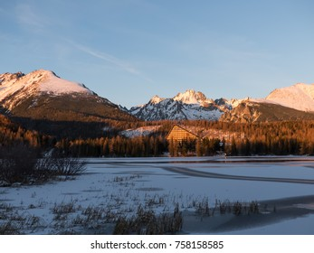 Sunset in Hight Tatras. Evening in winter mountains. Evening by the lake Strbske Pleso. Evening, sunset, mountains and winter.