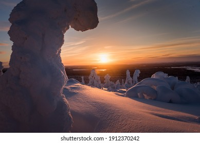 Sunset from a hill, over a snowy landscape