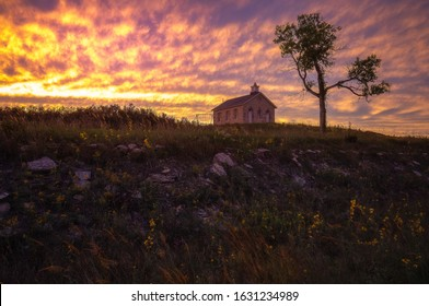 Sunset at a historic limestone schoolhouse