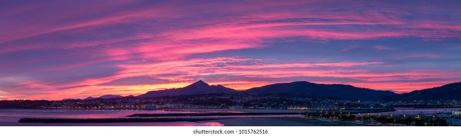Sunset from Hondarribia to the beach of hendaye at the other side of the border with france and mount La Rhune at the background