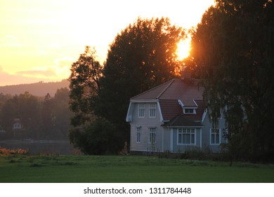 Sunset and a house