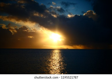 Sunset at Huahine with a view on Raiatea and Tahaa in the background - Huahine, French Polynesia