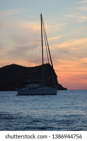 sunset in ibiza with a boat