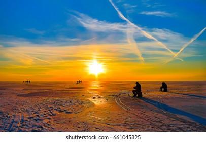 Sunset ice fishing winter landscape