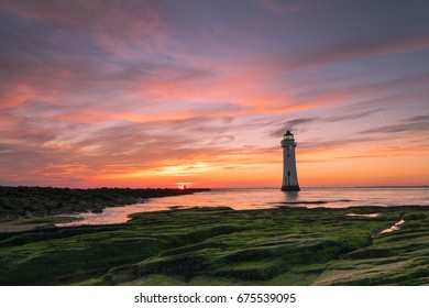 Sunset image of New Brighton lighthouse or Perch Rock which  is situated on the River Mersey and Liverpool Bay confluence.