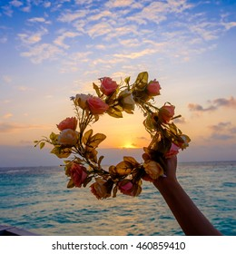 Sunset inside Beautiful Flower Crown over the sea (Victory concept)