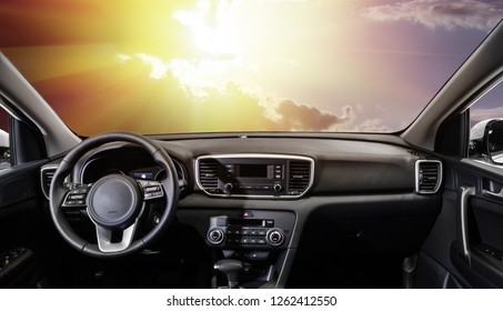 sunset from the interior of a modern car