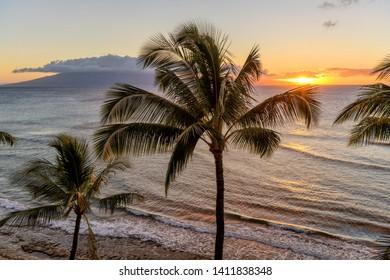 Sunset Island - A colorful sunset at north-west coast of Maui island, with Lanai island at horizon. Maui, Hawaii, USA.