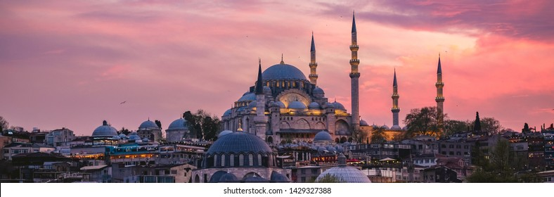 Sunset in Istanbul Panorama , Turkey with Suleymaniye Mosque (Ottoman imperial mosque). View from Galata Bridge in Istanbul.