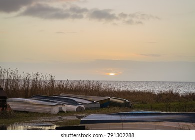 Sunset in January at Oresund between Denmark and Sweden and the skiffs landed