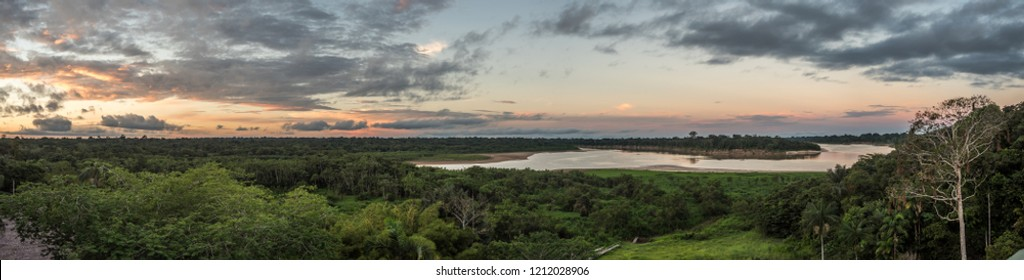 Sunset at the Javari River, the tributary of the Amazon River, Amazonia. Selva on the border of Brazil and Peru. South America.