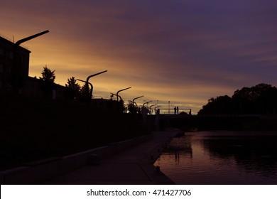 Sunset in Jelgava, Latvia. On the bridge, the couple enamored.