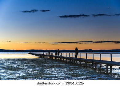 Sunset and Jetty at Tuggerah Lake at Long Jetty on the Central Coast of NSW, Australia.