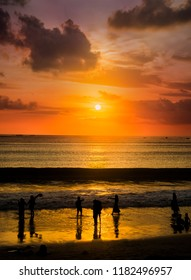 Sunset at Jimbaran beach. Bali's southwestern coast, Indonesia. Not only is Jimbaran Bay one of Bali's best places for memorable sunsets but also to enjoy grilled seafood