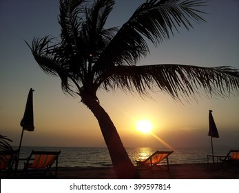 Sunset Jomtien Beach Pattaya Thailand, Sunset at the beach of pattaya with beach chair and palm tree