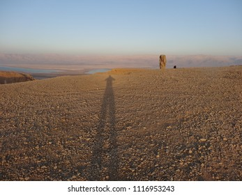 sunset in the Judea desert. you can see the Dead see and shadow of the photograper