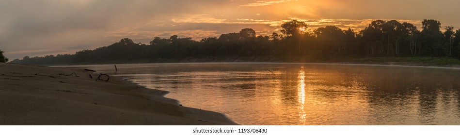 Sunset in the jungle over the Yavarii river during the low watr season. Amazon. Amazonia.
