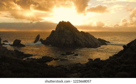 A sunset just behind this bizzare rock in Australia makes it a magical scenery. The contrast between the dark rock and the bright sun make this picture special