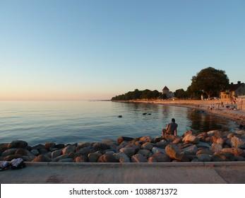 Sunset at Kallbadhuset and Strandpromenaden in Visby, Gotland Sweden.