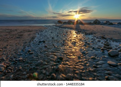 Sunset at Karkle beach, most popular  beach of  Baltic sea near Klaipeda in Lithuania