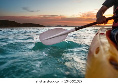 sunset kayaking at sea