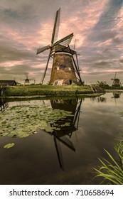Sunset at Kinderdijk, public free access windmills farm listed in the UNESCO world heritage sites list at Alblasserdam, nearby Rotterdam, Netherlands