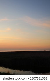 Sunset in Kintai, small fishing village in Lithuania near Curonian lagoon, with view to Curonian spit, dead dunes